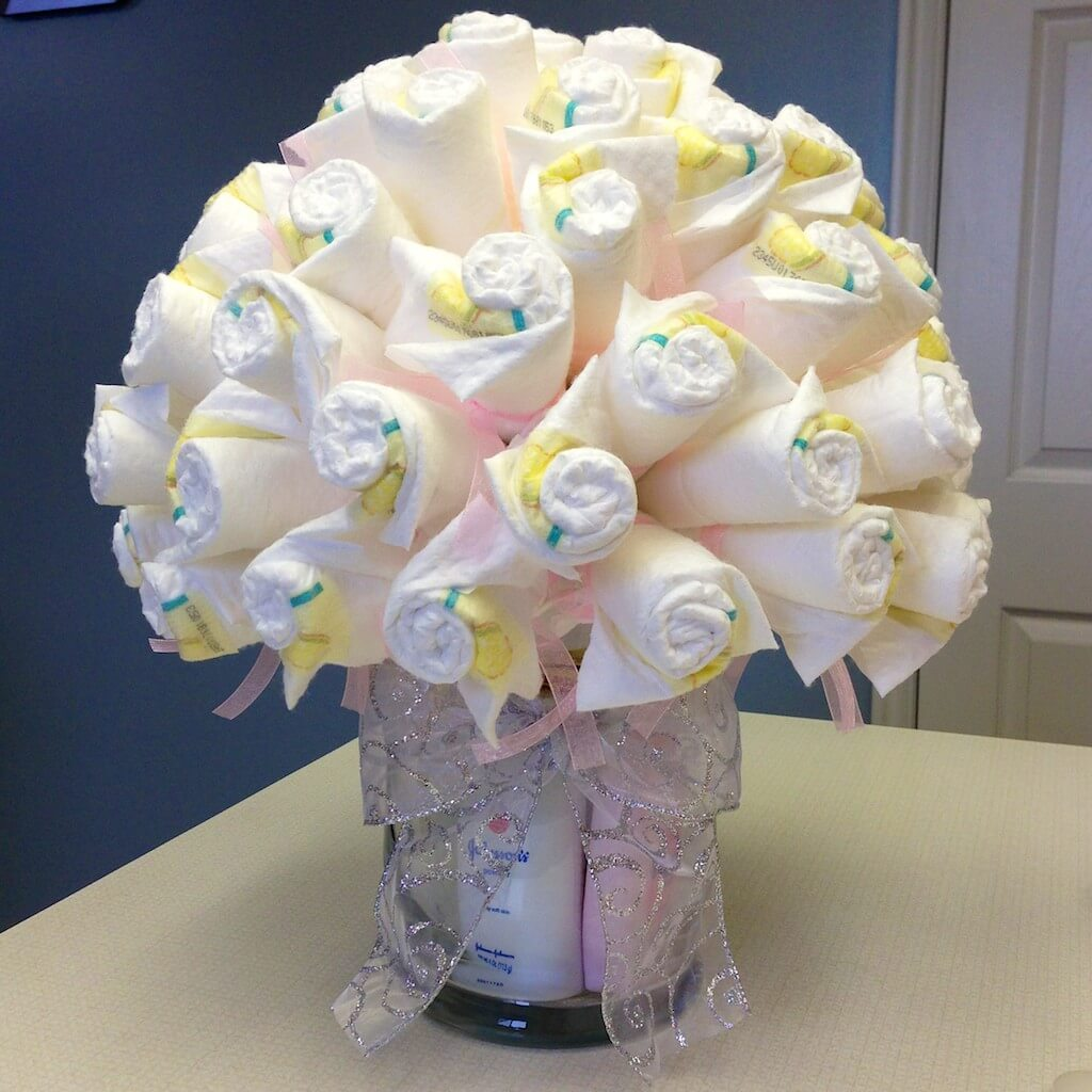 Diaper bouquet being genevieve for Baby shower diaper decoration